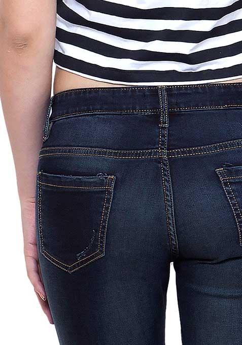 Ripped Skinny Jeans - Dark Wash